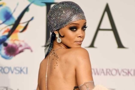 Rihanna accepts CFDA Icon of the Year Award in a gown too sheer to post here.